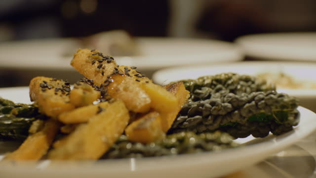 rack focus shot of food in plate at restaurant - food styling stock videos & royalty-free footage
