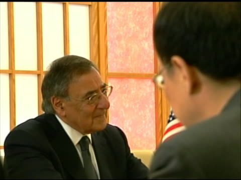 rack focus shot of leon panetta sitting at a conference table with japanese minister of foreign affairs koichiro gemba. this meeting took place in... - united states and (politics or government)点の映像素材/bロール