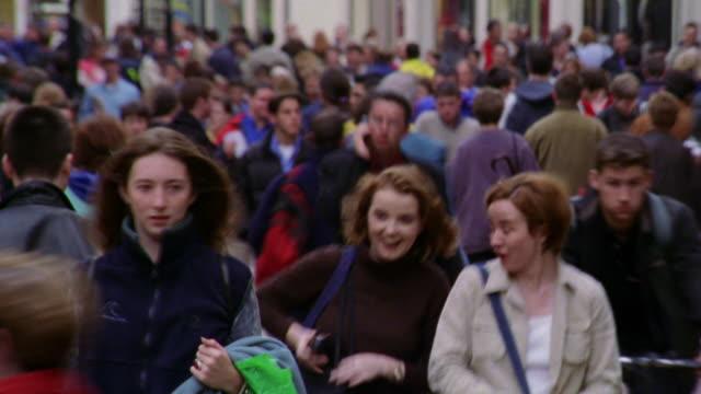 rack focus time lapse crowd of people walking on grafton street / dublin, ireland - dublin ireland stock videos and b-roll footage