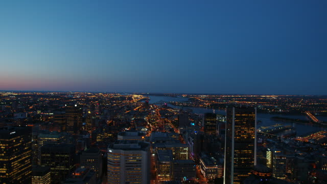 Rack focus to downtown Montreal at sunset