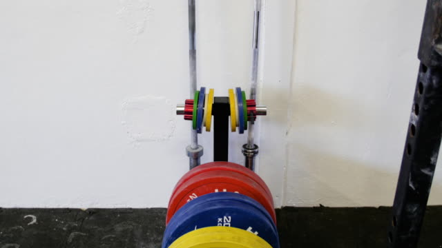 rack of barbell weight. - weight stock videos & royalty-free footage