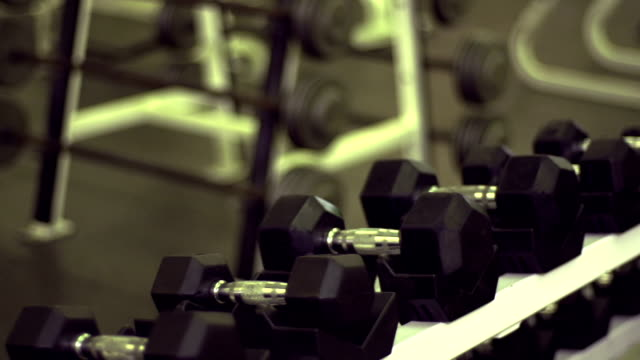 rack of dumbell weights - fatcamera stock videos and b-roll footage