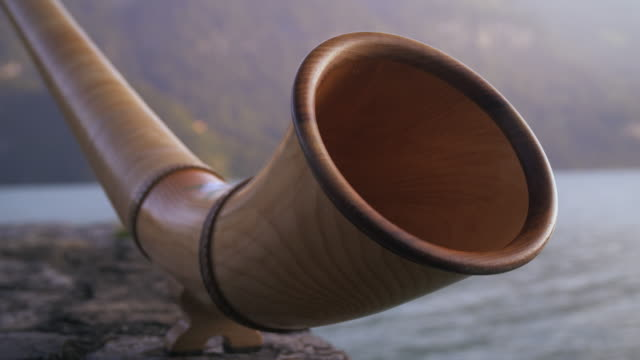 Racking-focus close-up of alphorn mouth
