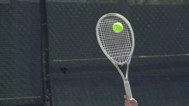 a racquet hitting a tennis ball.  - slow motion - tennis ball stock videos & royalty-free footage