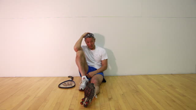 WS PAN Racquetball player sitting in court / Santa Fe, New Mexico, USA
