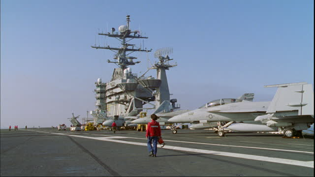 radar dishes spin atop the control tower of an aircraft carrier. - radar stock videos & royalty-free footage