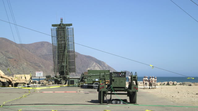 radar equipment spins at point mugu naval air station, troops nearby, wide shot - us air force stock videos & royalty-free footage