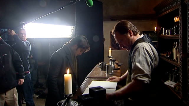 "radcliffe on ""the woman in black"" film set radcliffe and another actor filming scene ext radcliffe interview sot - [on how he will get rid of being... - film set stock videos & royalty-free footage"