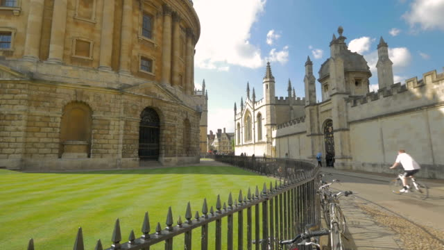 radcliffe square, oxford,tourists walking,bikes, - oxford england stock videos and b-roll footage