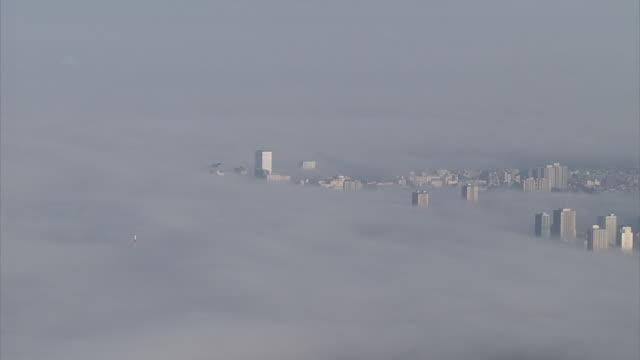 aerial, radiation fog over the city of saitama, japan - saitama city stock videos & royalty-free footage