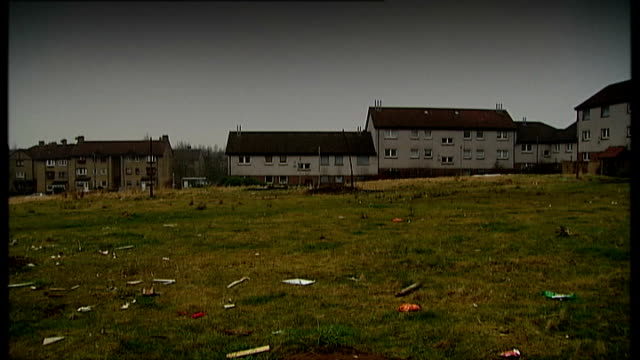 Radical reforms to welfare state begin File / Date Location Unknown EXT Houses on estate and rubbish on green in f/g Child's push along mower amongst...