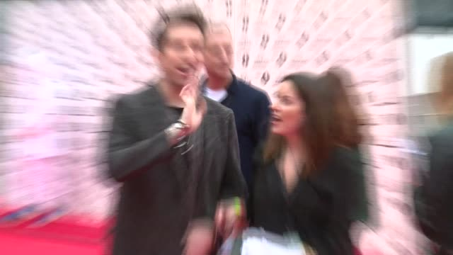 radio 1 teen awards red carpet; nick grimshaw poses on red carpet / nick grimshaw interview sot - bbc radio stock videos & royalty-free footage