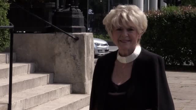 radio and television presenter, gloria hunniford, arrives for the funeral of dale winton. the funeral is being held on what would have been his 63rd... - グロリア ハニフォード点の映像素材/bロール