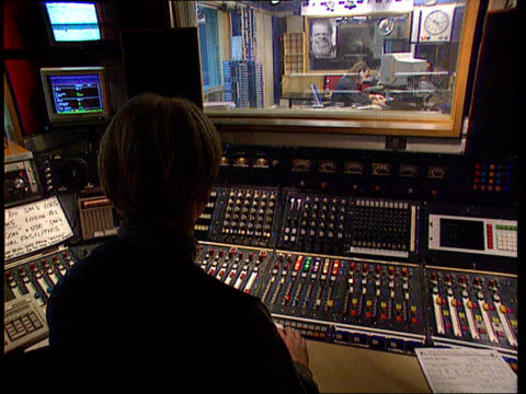 bbc radio audience figures report itn london cms red on air light in studio goes on cms hands manipulate controls on studio panel cs volume dials on... - bbc archive stock-videos und b-roll-filmmaterial