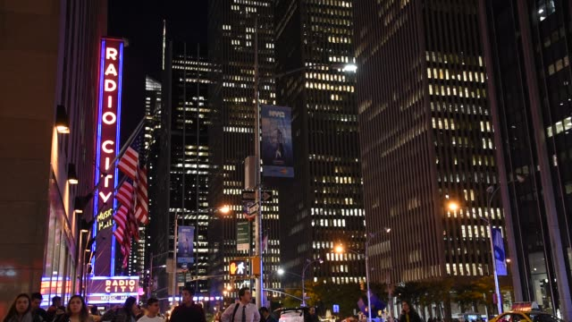 radio city building and everyday life in new york city at night - radio city music hall stock videos & royalty-free footage
