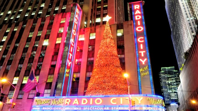 lapse radio city music hall entertainment venue avenue of the americas midtown manhattan new york city usa radio city decorated with christmas tree... - radio city music hall stock videos & royalty-free footage