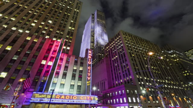 radio city music hall is an entertainment venue located in rockefeller center in new york city / midtown manhattan 6th ave new york city usa - radio city music hall stock videos & royalty-free footage