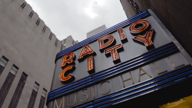 radio city music hall marquee entrance - establishing shot - new york city - june 2016 - radio city music hall stock videos & royalty-free footage
