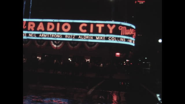 radio city music hall marquee in new york city with reaction to the apollo 11 moon landing. - radio city music hall stock videos & royalty-free footage
