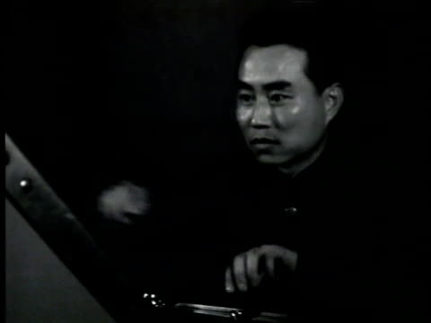 radio control room engineer working board madame sun yat sen on voice of china xgoy radio set reading script pages - widow stock videos and b-roll footage