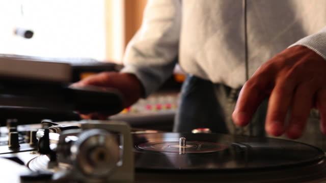 ms radio disc jockey operating disc dj system in his studio / santa fe, new mexico, united states - radio jockey stock videos & royalty-free footage