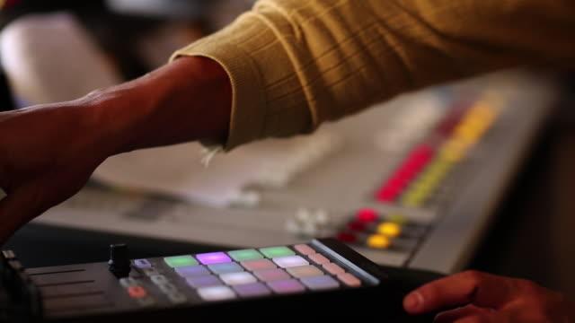 ms tu r/f radio disc jockey operating system and talking in mic in his studio / santa fe, new mexico, united states - radio jockey stock videos & royalty-free footage
