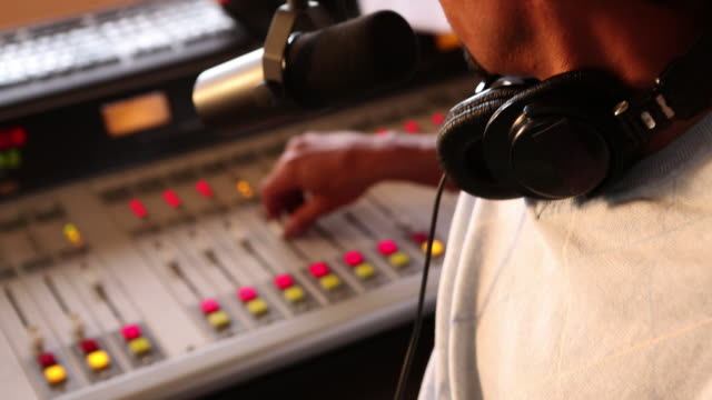 MS TU TD Radio disc jockey operating tab and system  in his studio / Santa Fe, New Mexico, United States