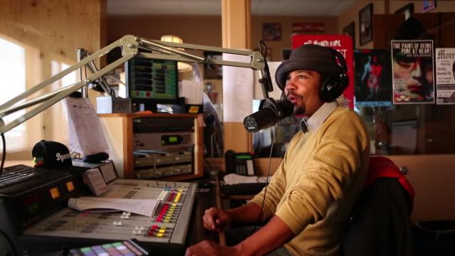 ms radio disc jockey reading and talking in mic in his studio / santa fe, new mexico, united states - radio jockey stock videos & royalty-free footage