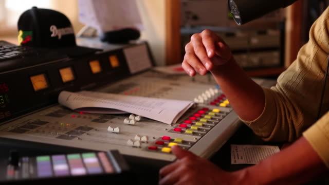 MS TU Radio disc jockey talking in mic in his studio / Santa Fe, New Mexico, United States