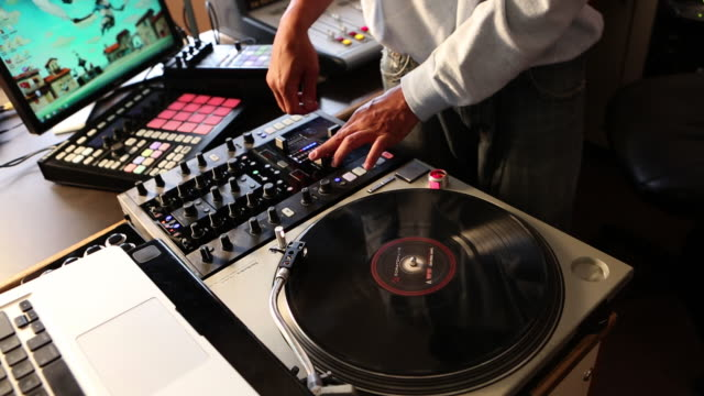 ms radio disc jockey working in his studio / santa fe, new mexico, united states - dj stock videos & royalty-free footage