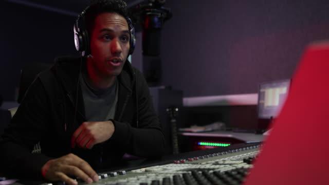 radio dj in a recording studio - hörfunksender stock-videos und b-roll-filmmaterial
