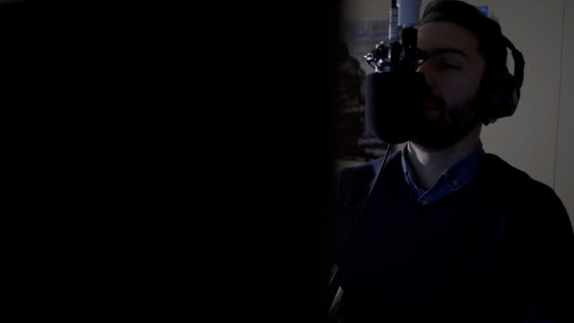 radio dj in studio talking with audience - microphone stock videos & royalty-free footage