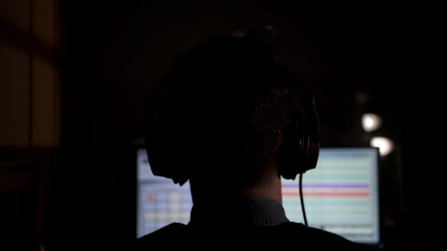 radio dj putting headphones on his ears - computer monitor back stock videos & royalty-free footage