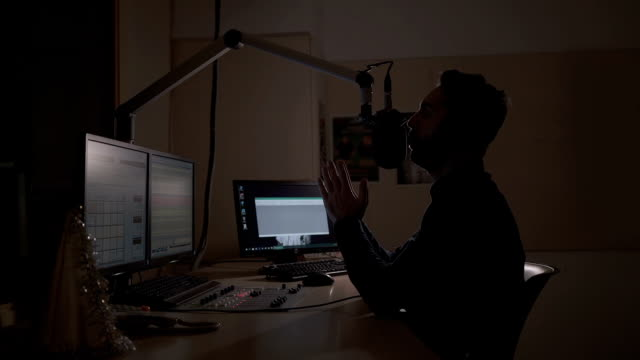 radio dj working in recording studio - workshop stock videos & royalty-free footage