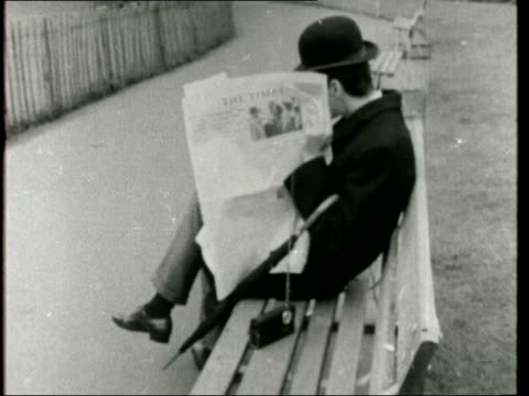 radio london goes off the air radio london goes off the air 203/16/1/r'66 st james' park pull out to man wearing bowler hat on park bench ms girl... - swinging stock videos & royalty-free footage