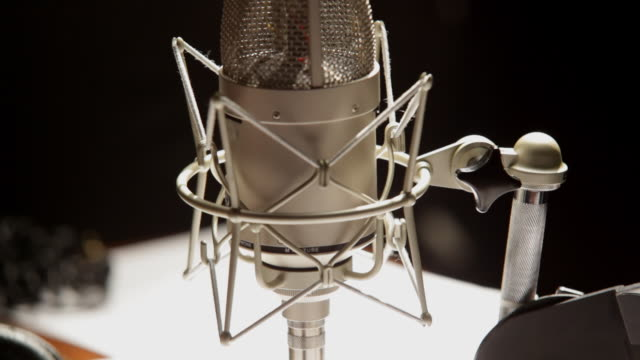 a radio microphone on a table - radio studio stock videos & royalty-free footage