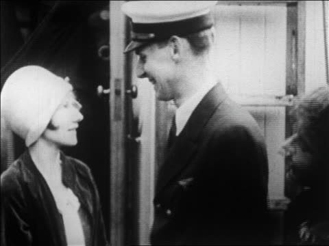 radio operator for byrd's expedition to antarctica embracing wife / newsreel - 1926 stock-videos und b-roll-filmmaterial