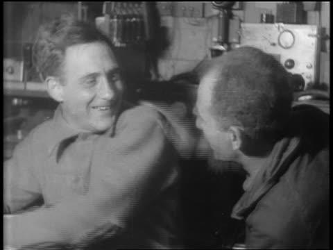 vídeos de stock e filmes b-roll de radio operator + other man pat each other on backs / admiral byrd's flight over south pole - 1920 1929