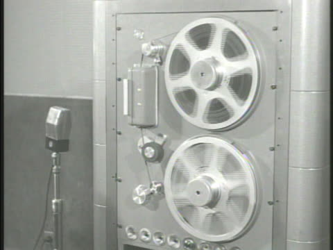 radio station building sign, 'radio tokyo.' int vs reel of taped recording spinning, radio operator control panel, tape spinning . - radio studio stock videos & royalty-free footage