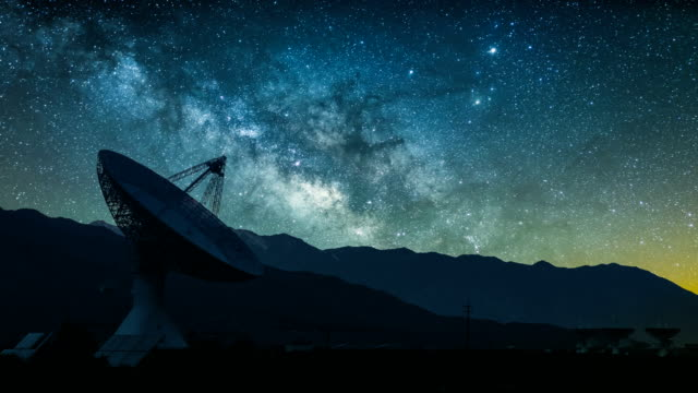 radio telescope against rising milky way - astronomical telescope stock videos & royalty-free footage