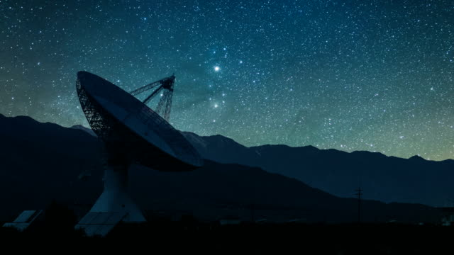 radio telescope observatory with rising milky way, zoom out - observatory stock videos & royalty-free footage