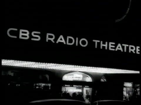 radio theatre nbc neon sign broadcast studio clock 'on the air' sign lighting up comedian jack benny holding script laughing behind nbc mic laughing... - radio studio stock videos & royalty-free footage