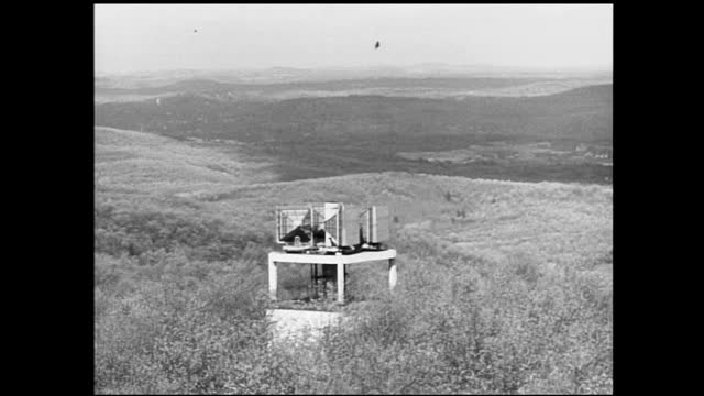 vídeos y material grabado en eventos de stock de radio tower against the sky with cables; another radio tower against the cloudy sky; trees and radio tower on a hill in the distance; radio tower in... - 1940 1949