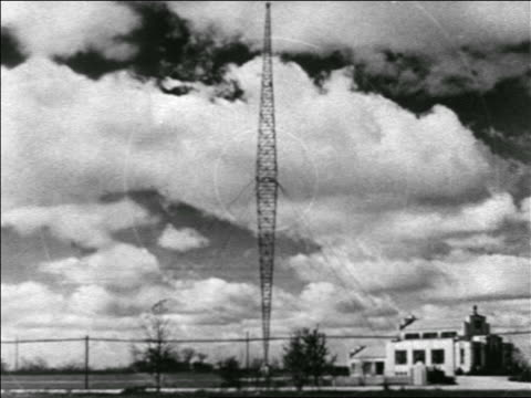 b/w 1938 radio tower emitting animated signals / educational / industrial - communications tower stock videos & royalty-free footage