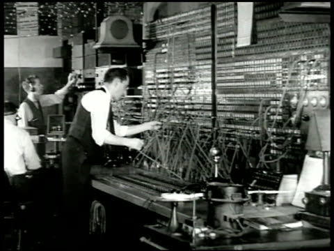 vídeos de stock e filmes b-roll de radio tower & power lines. engineer working control panel in radio station. radio broadcaster speaking in italian sot saying when italy quits war... - nazism