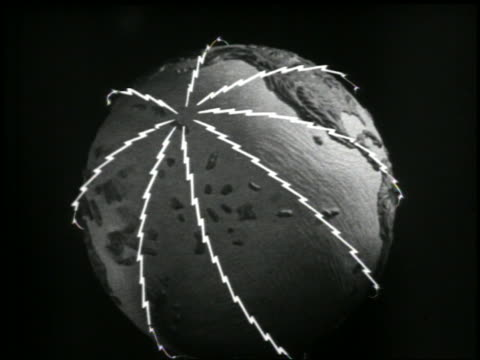 B/W 1946 radio waves emitting from North Pole on globe / globe starts spinning / newsreel