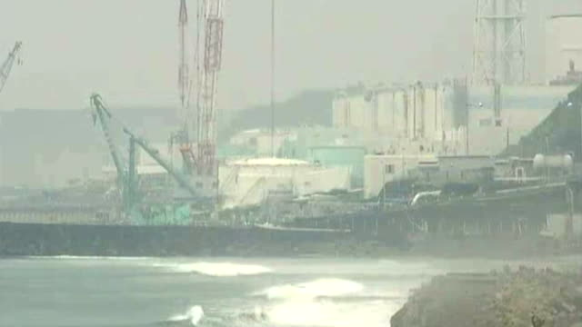 radioactive water leak from fukushima nuclear plant; lib japan: fukushima: daiichi nuclear plant: ext long shots of damaged daiichi nuclear plant - nuclear energy stock videos & royalty-free footage