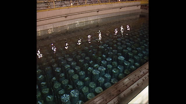 radiocative fuel and spent nuclear fuel storage pool at reprocessing plant at sellafield nuclear site, 1998 - radiation stock videos & royalty-free footage