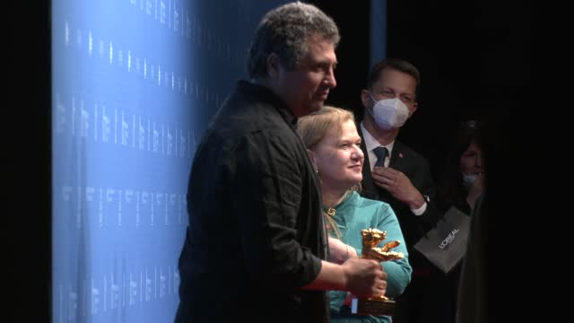"""radu jude and ada solomon, winner of the golden bear for best film for their movie """"babardeală cu bucluc sau porno balamuc"""" poses with their trophy... - celeb stock videos & royalty-free footage"""