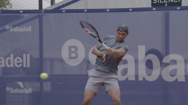 rafa nadal is seen training at the barcelona open banc sabadell 2015 during a open media session on april 19th 2015 in barcelona spain - media training stock videos and b-roll footage